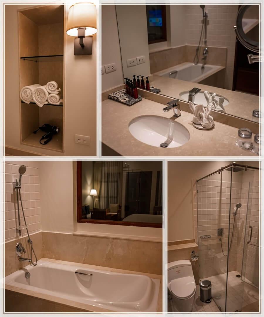 Bad mit Handtüchern im Deluxe Doppelzimmer