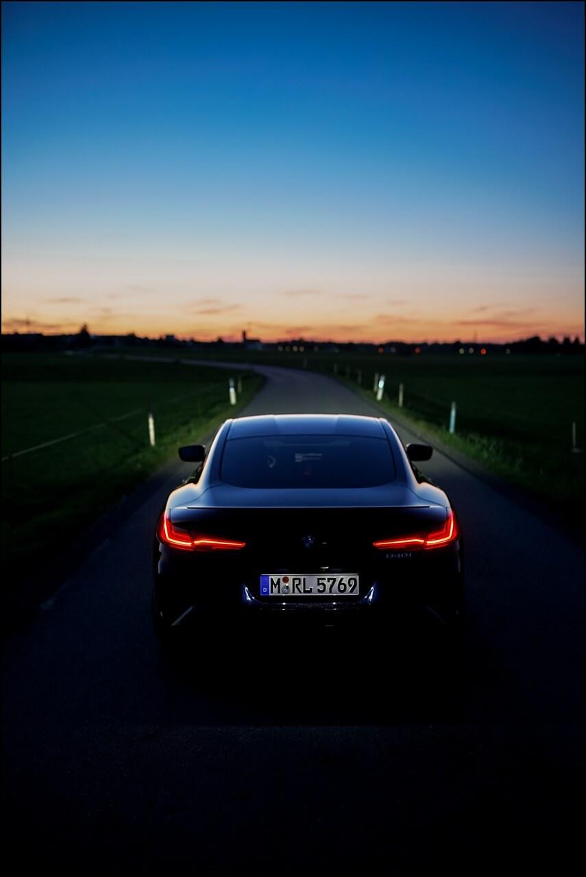 Heckpartie vom BMW 840i in Carbon-schwarz